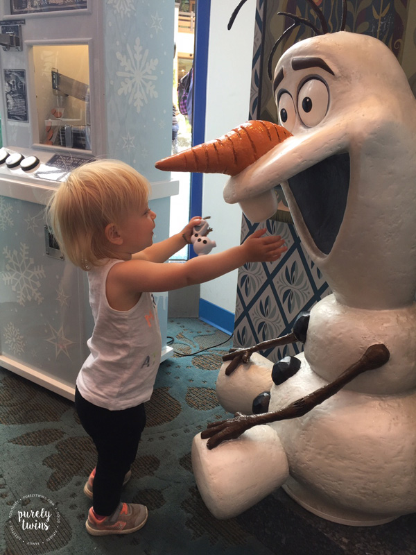 Meeting Olaf statue at toy store.