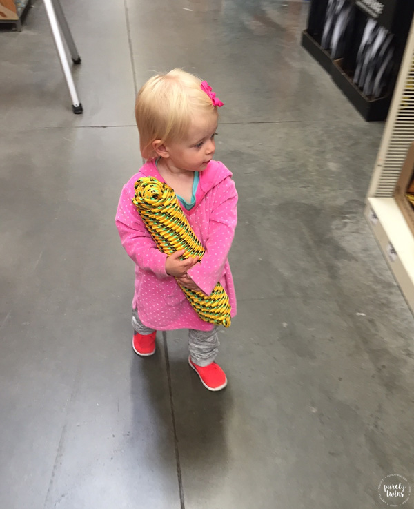Toddler walking around home depot