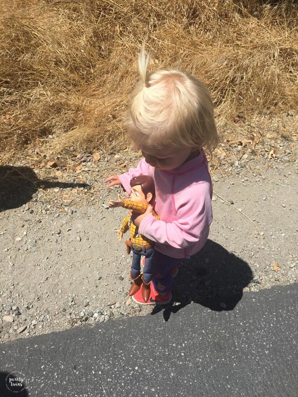toddler-walking-around-with-disney-woody-toy