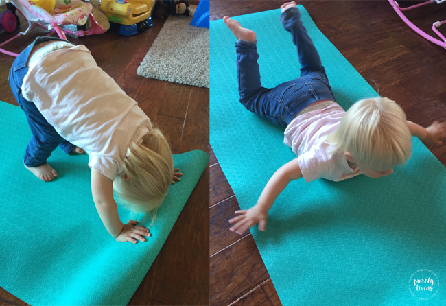 Toddler working out using Tone It Up Yoga mat