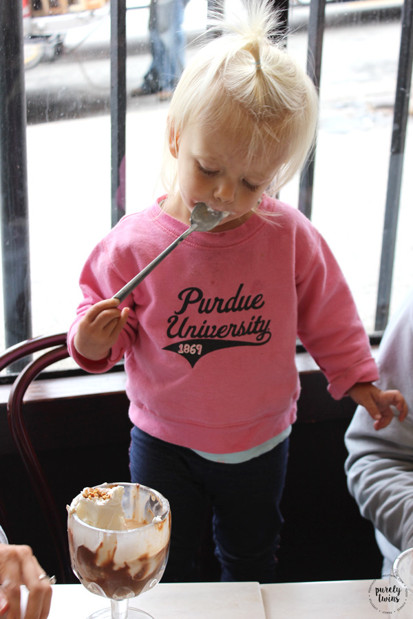 Toddler eating ice cream from Ghirardelli ice cream-chocolate shop San Francisco