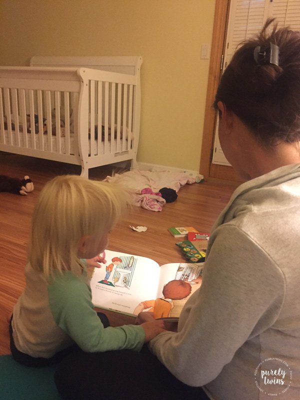 Reading stories to first child while being pregnant with second little girl.