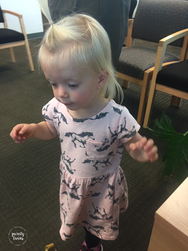 Toddler playing at doctors office.