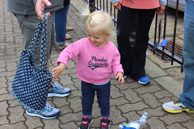 Toddler girl playing with purse