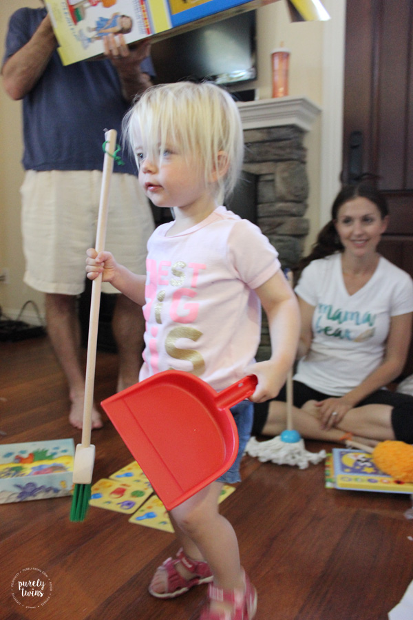2-year-old-playing-with-broom-set-from-birthday-party