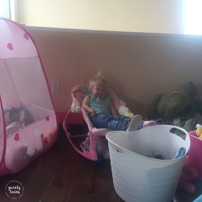 2-year-old-toddler-girl-sitting-in-her-rocking-chair