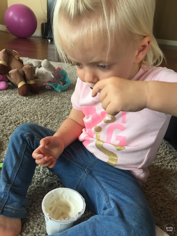 Toddler eating yogurt