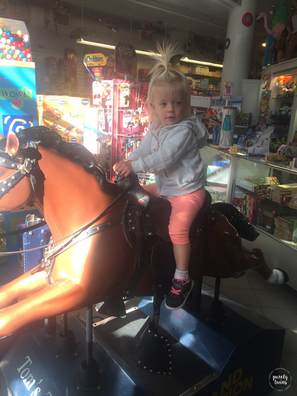 toddler-on-play-horse-in-toy-store