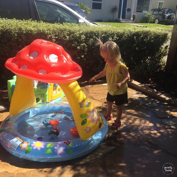 toddler-playing-in-water