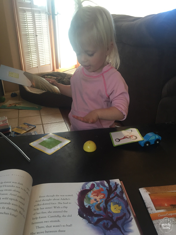 toddler-reading-book-to-mom