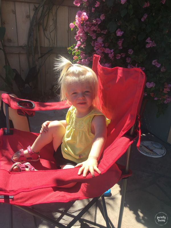 toddler-sitting-in-chair-outside