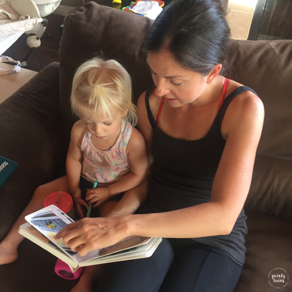 Aunt reading book to niece that is 2 years old