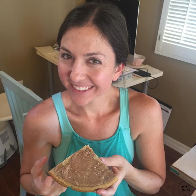 Eating gluten-free paleo plantain bread with almond butter for lunch one day.