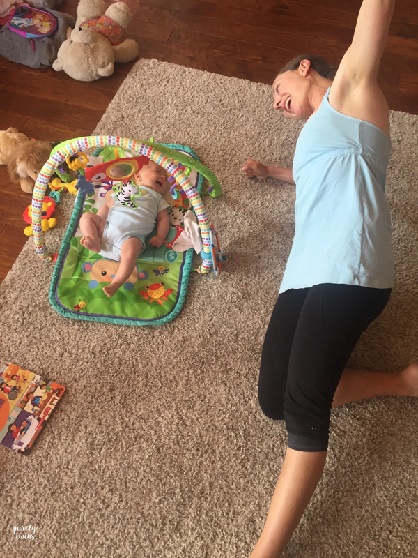 mom doing core work with 2 month old baby watching