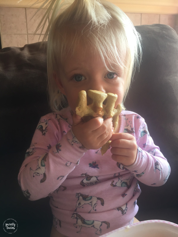 Toddler eating plantain waffles