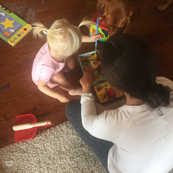 toddler-playing-fish-board-game-with-aunt