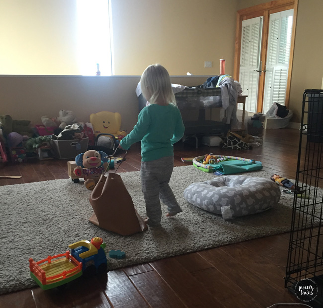 Toddler playing with moms purse