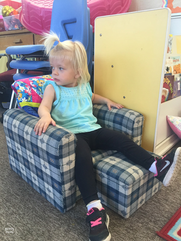 Toddler relaxing on chair.