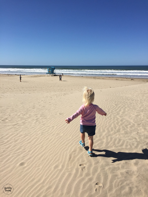 Toddler running on pismo beach