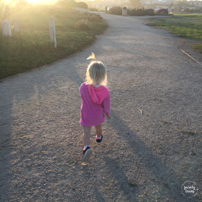 2 year old girl running at local park in California.