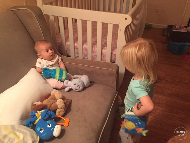 Older sister talking to baby sister before bed time.