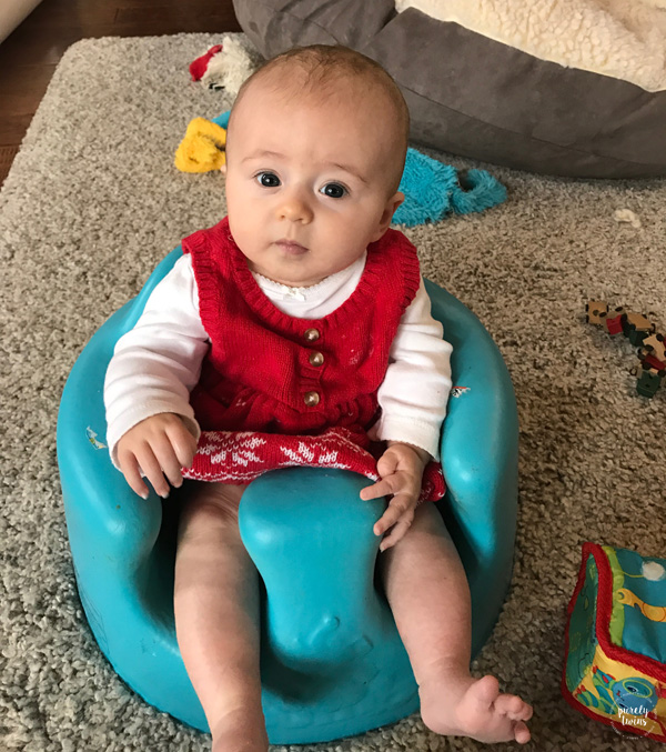 3 month old baby sitting in bumbo seat