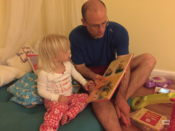 dad-reading-to-his-little-2-year-old-girl