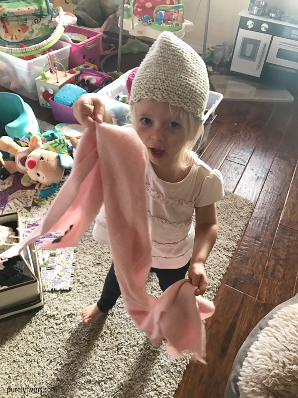 2 year old girl playing in her moms clothes
