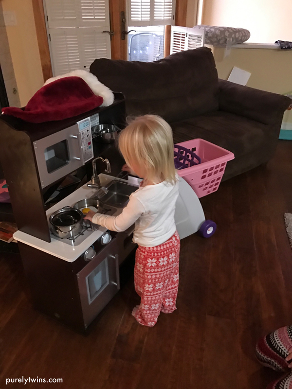 2 year old seeing her mini kitchen for the first time on Christmas morning.