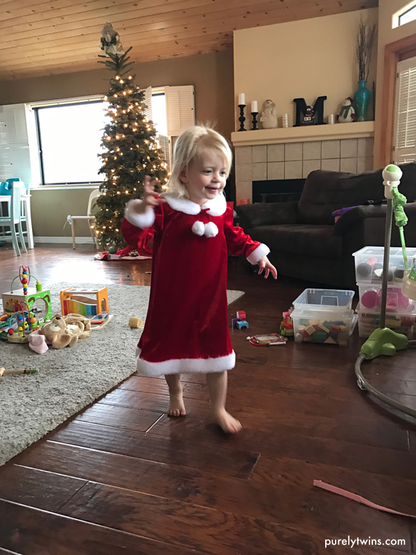 2 year old wearing her Christmas Santa dress.