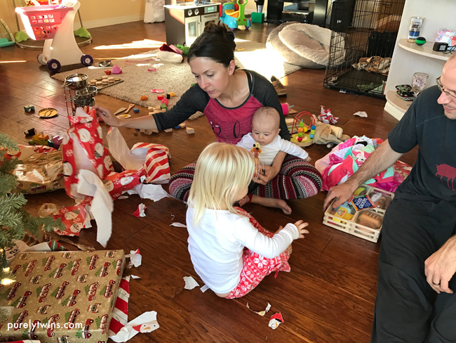Christmas day opening presents as a new family of 4 in California.
