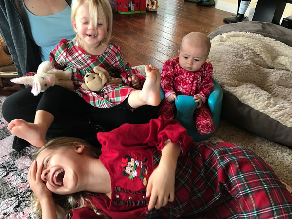 Family Christmas photo of 3 cousin girls