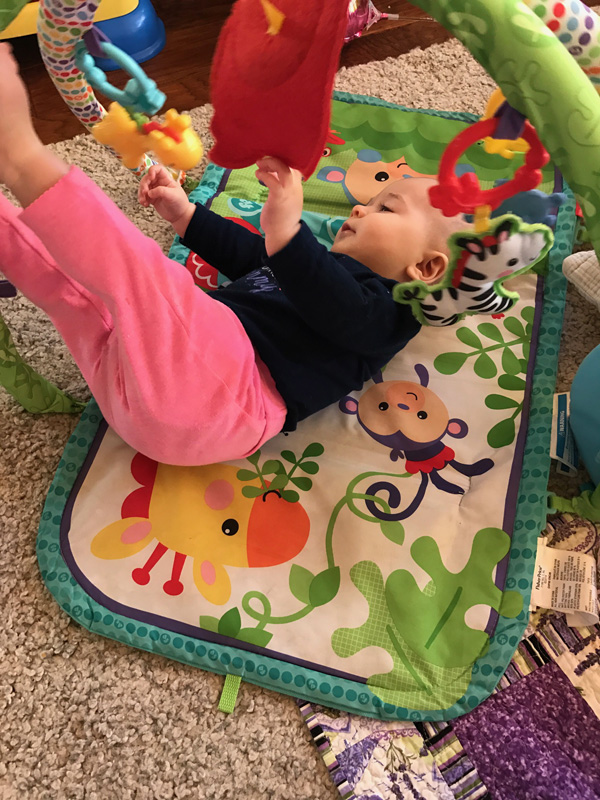 6 month old rolling around on activity mat.