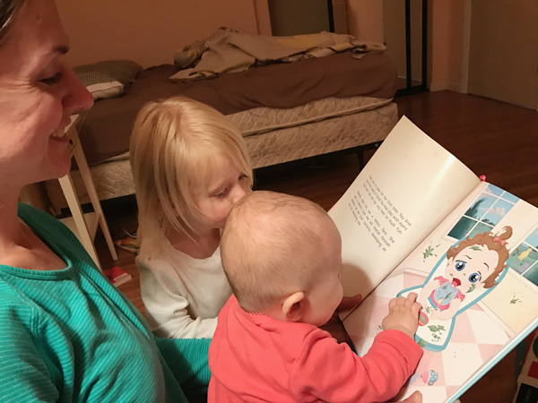 Family reading books before bed
