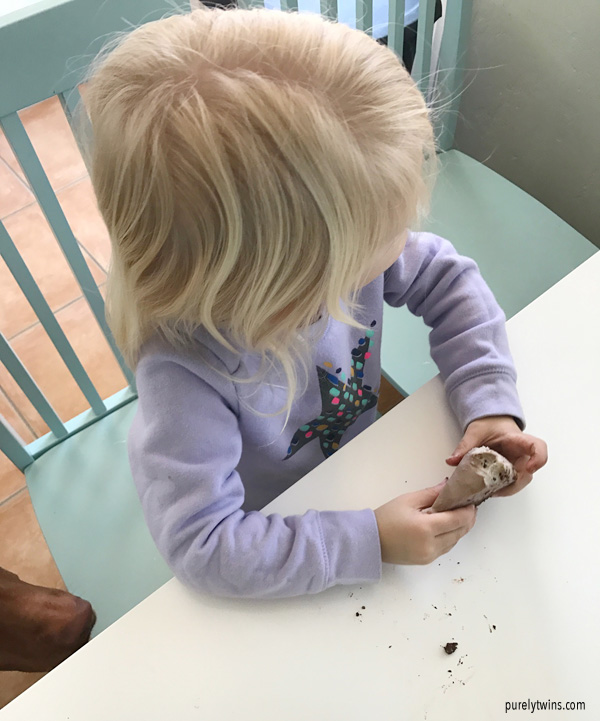 Two year old girl eating raw dessert
