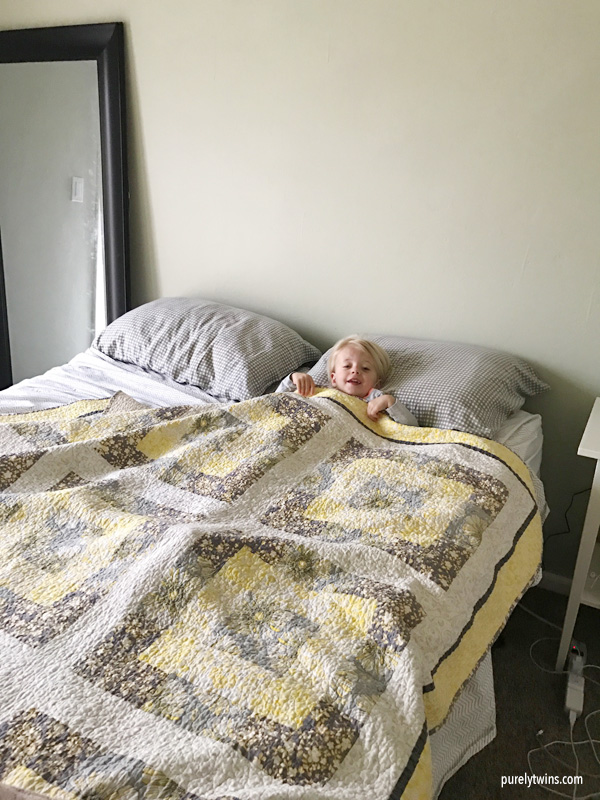 toddler in parents bed