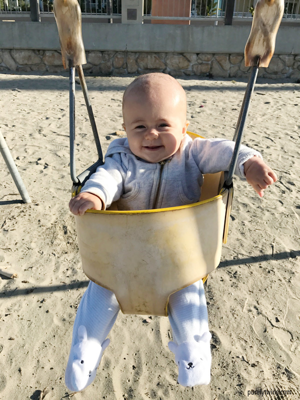 Baby's first time swinging