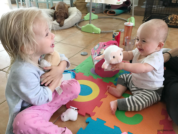 sisters playing easter toys