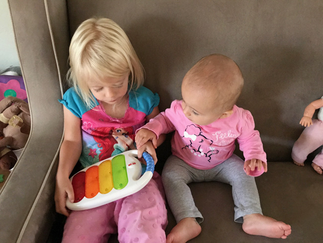 sisters playing