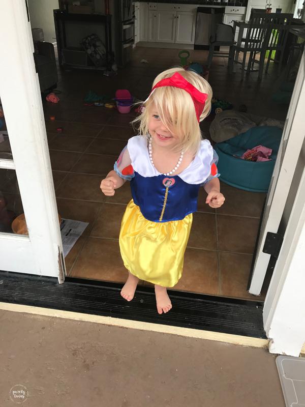 toddler girl dressed up as snow white disney princess