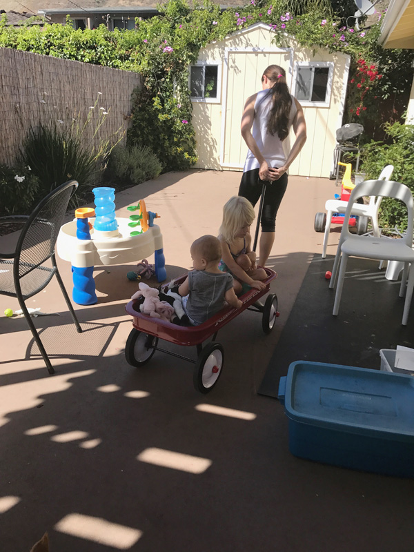 mom pulling wagon with her kids