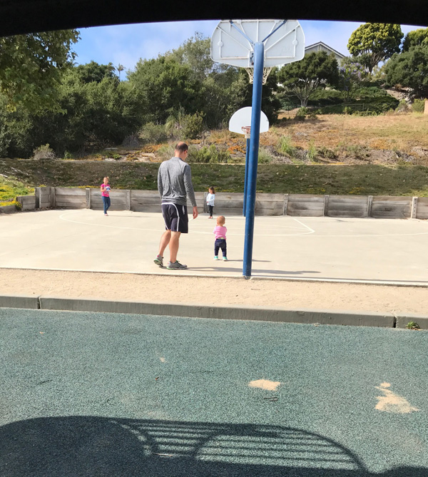 playing at park dad and daughter