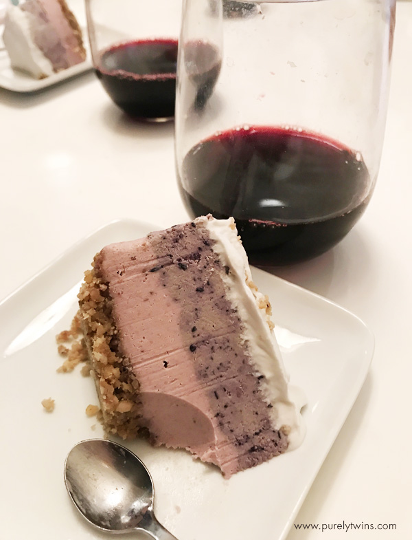 Enjoying a balanced mindful way of eating with some wine and triple berry homemade dairy-free cheesecake for dessert