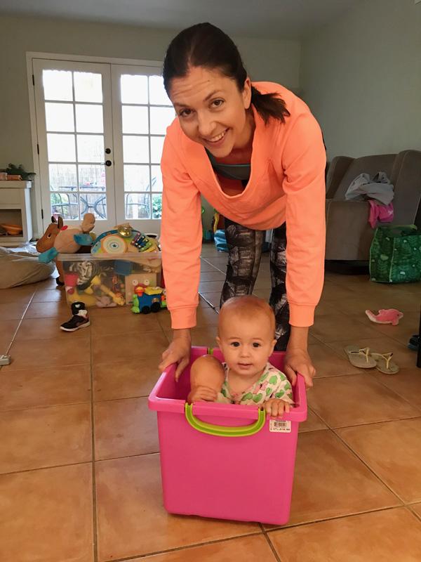 aunt pushing niece around in box