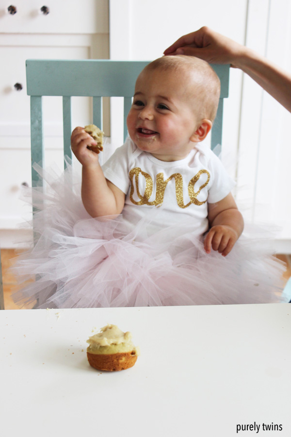 one-year-old-girl-eating-her-homemade-cupcakes